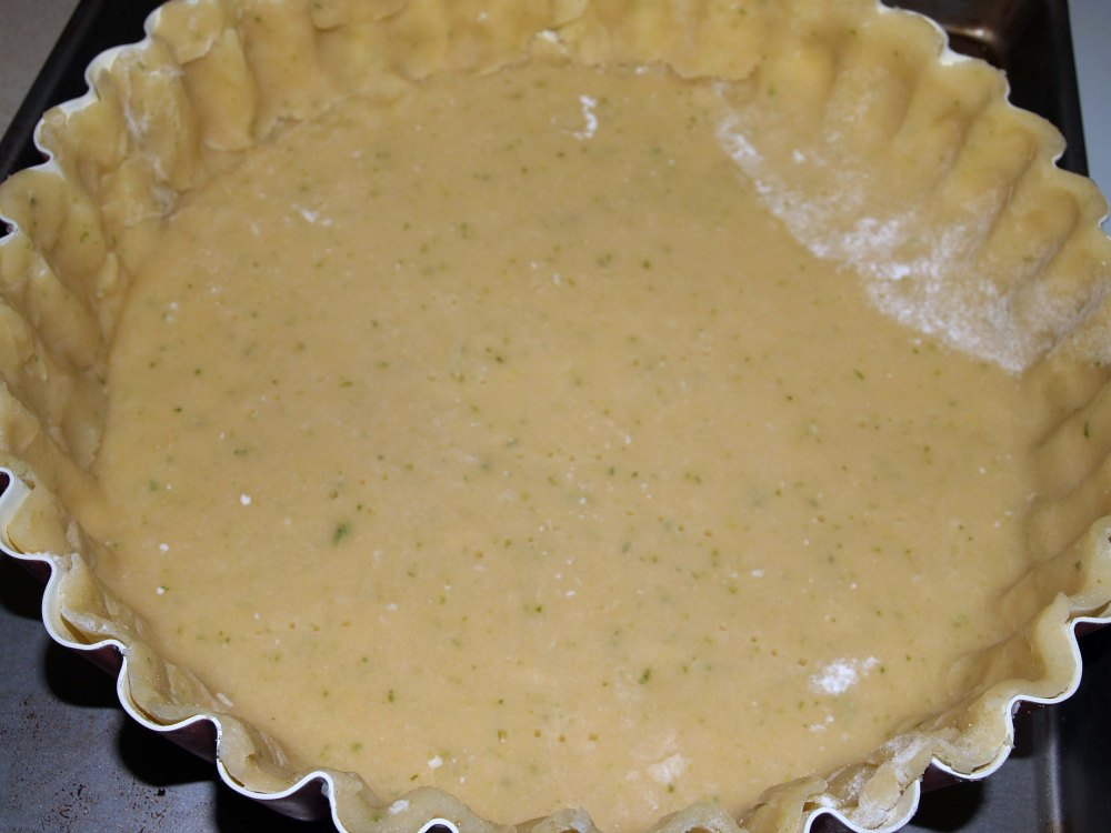 crust in tart pan ready to bake