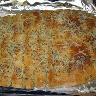 Garlic Herb Breadsticks with Parmesan Herb Topping