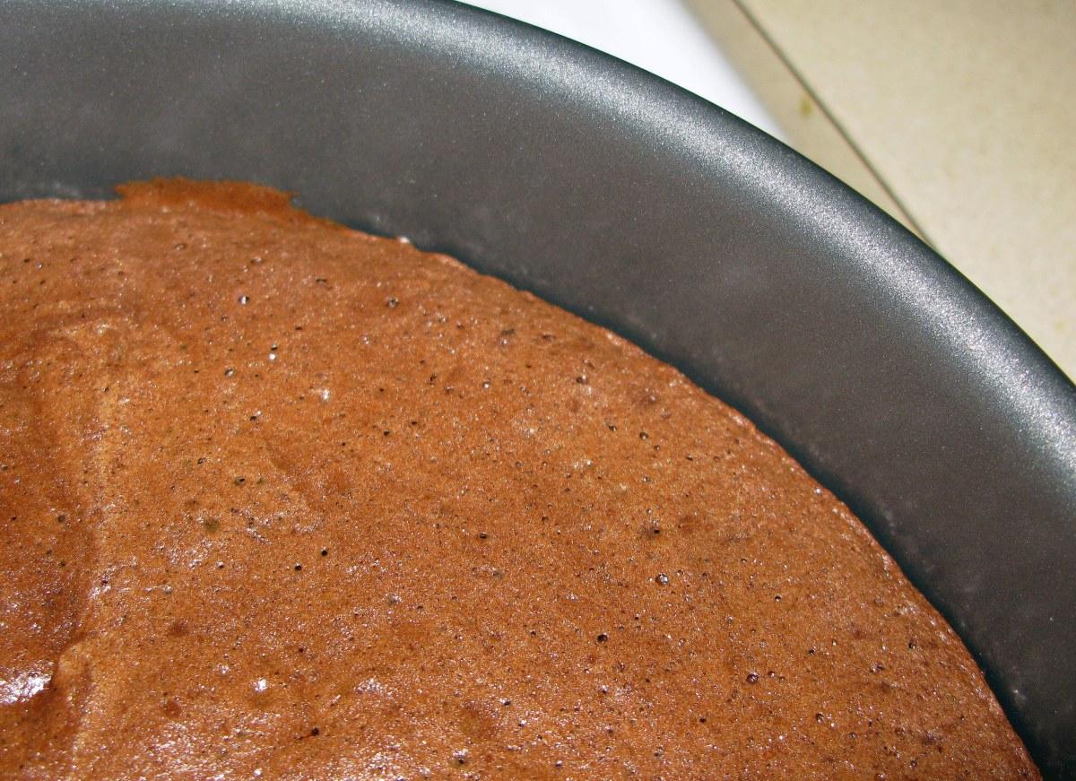 Coffee Chocolate Cake Pulling Away from Edge of Pan